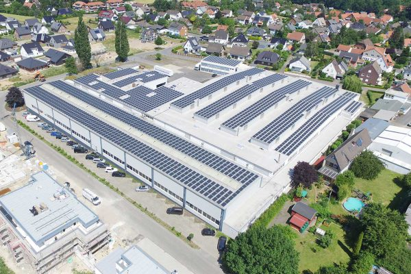 652 tons of CO2 per year saved with a hall roof